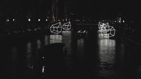 Cruise boat in night canals of Amsterdam. Slow Motion Video. stock video