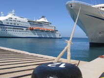 Cruise boat at port. A view of two enormous cruises boat in a port in Greece Royalty Free Stock Photos