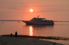 Cruise boat at sunset. Pulling back into port Royalty Free Stock Photo