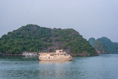 Cruise boat at sunset Halong bay Stock Photo