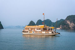 Cruise boat at sunset Halong bay Royalty Free Stock Photos