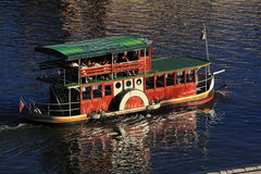 A cruise boat on the Vltava River in Prague, Czech Republic Royalty Free Stock Photos