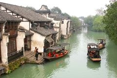 Tourist canal boats in the ancient water town Wuzhen (Unesco), China Royalty Free Stock Images