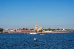 Cruise boats goes along the Neva River. With a  view of the Peter and Paul fortress Stock Photos
