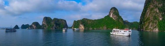 Cruise boats in Halong Bay, Vietnam, panorama. Cruise boats in Halong Bay, Vietnam, Southeast Asia. UNESCO World Heritage Site. Panorama royalty free stock image