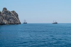Cruise boats with tourists on Board, sailing along the magnificent scenic route along the Mediterranean coast Stock Images
