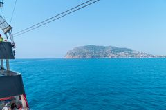 Cruise boats with tourists on Board, sailing along the magnificent scenic route along the Mediterranean coast Royalty Free Stock Images
