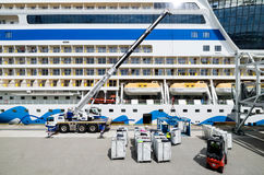 Cruise Center Steinwerder. Luggage being loaded into AIDAsol at Cruise Center Steinwerder. AIDA Cruises is one of ten brands owned by Carnival Corp Royalty Free Stock Photo