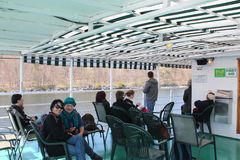 Cruise at Crawford Wharf Kingston, Canada. Kingston, Canada – May 4, 2013: Asian and American tourists cruise the Crawford Wharf at Kingston, Canada Stock Photography