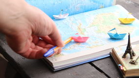 Cruise deals idea. Paper boats on the map and the Eiffel Tower. Travel to World. Tourism. Paper boats on the map stock video