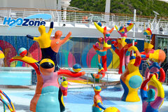 Cruise deck children`s pool area. The is the pool area called the H2O zone for children`s enjoyment .  This pool is located on the Royal Caribbean Cruise Line Royalty Free Stock Photography