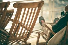 Cruise Deckchair Relaxing. Men Enjoying His Vacation stock photos