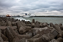 Cruise ferry leaving to the open sea. On cloudy stormy day Stock Photo