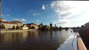 Cruise in front of the Charles Bridge on the Vltava River in Prague, stock video footage