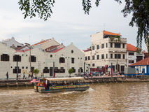 A cruise full of passenger crossing by the Malacca River. Stock Images