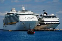 Cruise Giants. Cruise liners just arrived to Cozumel island, Mexico, one of the most popular destinations in Caribbean Royalty Free Stock Photo