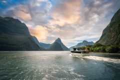 A Cruise going into Sunset at Milford Sound. A fiord in the southwest of New Zealand's South Island. Milford Sound is a fusion of spectacular natural Stock Images