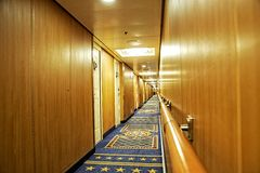 Cruise hallway. Interior of a cruise. A long hallway with no people,very upscale Stock Images