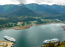 Cruise Harbor. Juneau, AK, USA - May 25, 2016: Two cruise ships docked in the Juneau ship harbor royalty free stock photography
