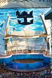 Cruise High Dive. EASTERN CARIBBEAN - JAN. 17: Royal Caribbean's Oasis of the Seas pool (the deepest at sea) is an amphitheater, hosting a diving show where Stock Photo