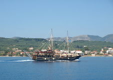 The cruise of the island of Zakynthos. Ship with tourists on the Ionian sea Stock Photo