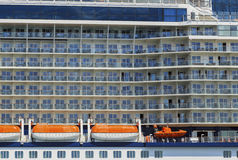 Cruise line ship side with lifeboats and balcony stateroom. Stock Image