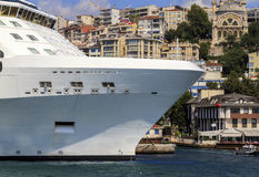 Cruise line ship side with small ship. Royalty Free Stock Photos