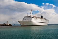 Cruise liner. Coming into the port area Royalty Free Stock Photo