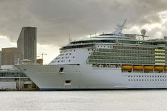 Cruise Liner. Cruise ship with buildings at background royalty free stock photo