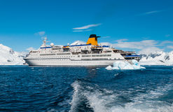 Cruise liner in Antarctica. Snow mountains background Royalty Free Stock Image