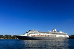 Cruise Liner and blue sky. Large Cruise Ocean Liner at sea under blue skies Royalty Free Stock Image