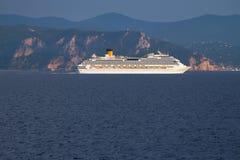 Cruise liner at cape Noli. Savona, Italy Stock Photos