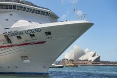 Cruise liner Carnival Legend and Sydney Opera House in the background stock images