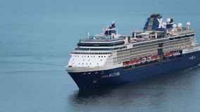 Cruise Liner Celebrity Millennium maneuvers in Pacific Ocean. Zoom in stock video footage
