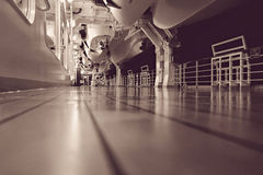 Cruise liner deck at night. Illuminated deck of cruise ship at night, monochrome image Royalty Free Stock Photos
