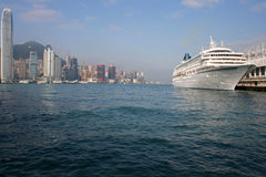 A cruise liner docks at Victoria Harbor in Hong Kong. Hong Kong, China - April 9 - A cruise liner docks at Ocean Terminal Victoria Harbor in Hong Kong stock photos