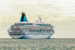 Cruise liner entering Baltic sea. White passenger ship royalty free stock photo