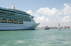 Cruise Liner entering Venice. VENICE, ITALY - JUNE 6: The large cruise ship Serenade of the Seas sailing into Venice on June 6 2013.  There have been many Stock Photo