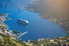 The cruise liner enters the bay. The cruise liner enters the Gulf of Kotor Royalty Free Stock Photo