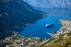 The cruise liner enters the bay. Of Kotor Stock Photography