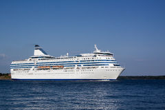 The cruise liner floats by sea Stock Images