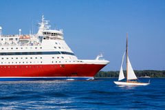 The cruise liner floats by sea. The passenger cruise liner floats by sea by the island stock images