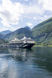 Cruise liner in Geirangerfjord sea port with tourists on June 29, 2016 in Geiranger, Norway. Stock Image