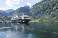 Cruise liner in Geirangerfjord sea port with tourists on June 29, 2016 in Geiranger, Norway. Royalty Free Stock Image