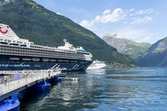Cruise liner in Geirangerfjord sea port with tourists on June 29, 2016 in Geiranger, Norway. Royalty Free Stock Photography
