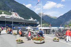 Cruise liner in Geirangerfjord sea port with tourists on June 29, 2016 in Geiranger, Norway Royalty Free Stock Image