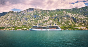 Cruise liner goes to Kotor by small old authentic towns. Boka Kotorska gulf, Montenegro. Cruise liner goes to Kotor by small old authentic towns. Boka Kotorska stock image