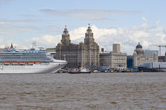Cruise Liner in Liverpool. Cruise liner berthed in Liverpool UK with the famous skyline including the Liverbirds in the background also showing the Mersey Ferry Royalty Free Stock Photos