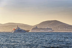 Cruise liner and luxury yachts in Saint Tropez harbor Stock Photography
