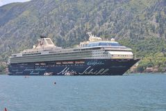 Cruise liner Mein Schiff in the Bay of Kotor. Kotor, Montenegro – July 7, 2016: Cruise liner Mein Schiff disembarking tourists in the Bay of Kotor Stock Photography